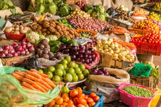 Colorful fruits and vegetables colorfully arranged at a local fruit and vegetable market in Nairobi, Kenya.